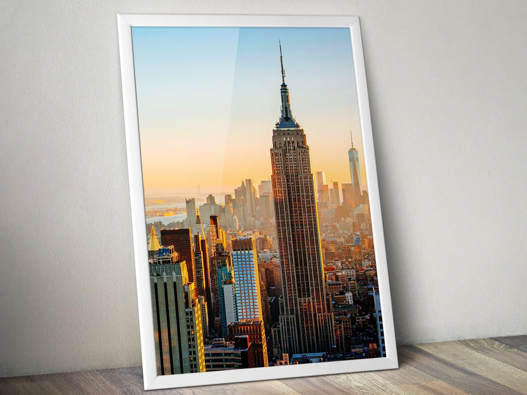 A framed poster of Empire State Building