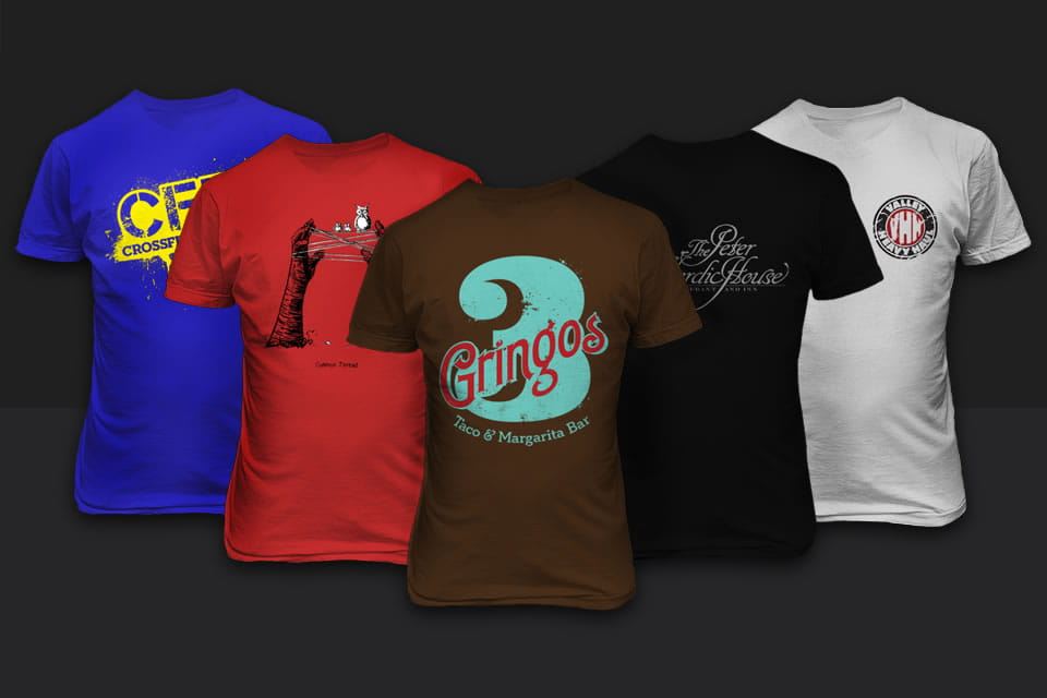 A group of custom designed printed t-shirts