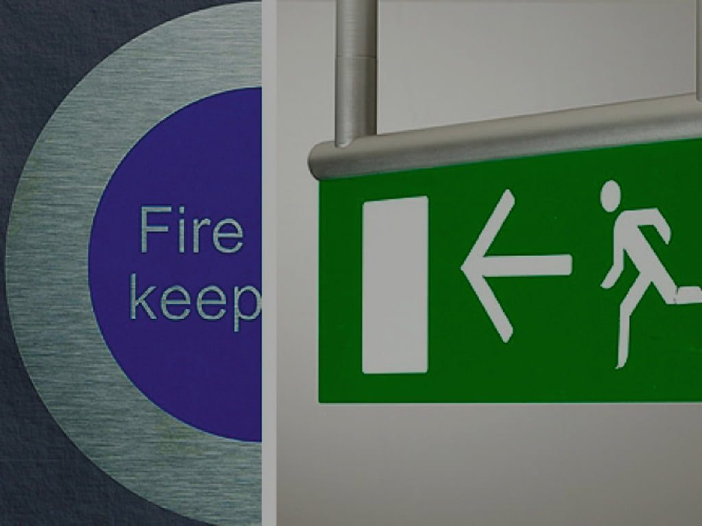Statutory fire escape and keep clear sign